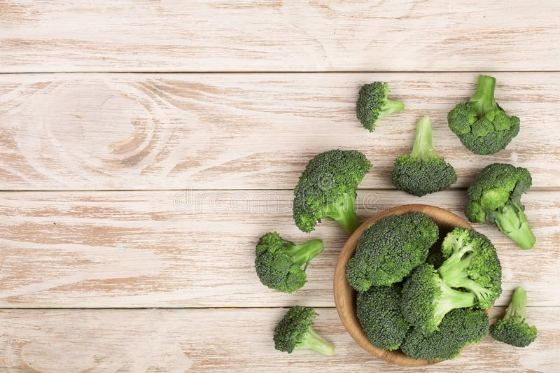 Fresh broccoli on white wooden background with copy space for your text. Top view. Fresh broccoli isolated on white background with copy space for your text. Top royalty free stock photography