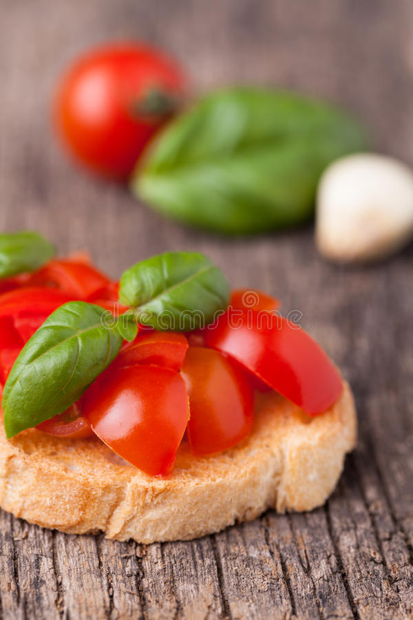 Fresh bruschetta with tomato. And basil stock images