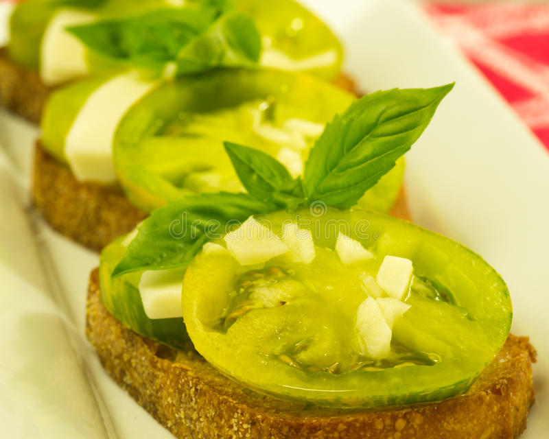 Fresh bruschetta with tomatoes cheese and basil royalty free stock photo