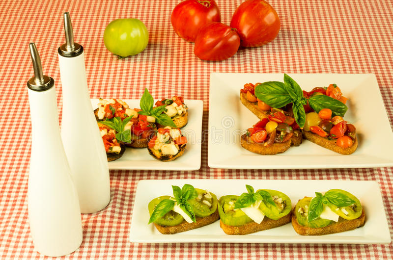 Fresh bruschetta tomatoes cheese basil stock image