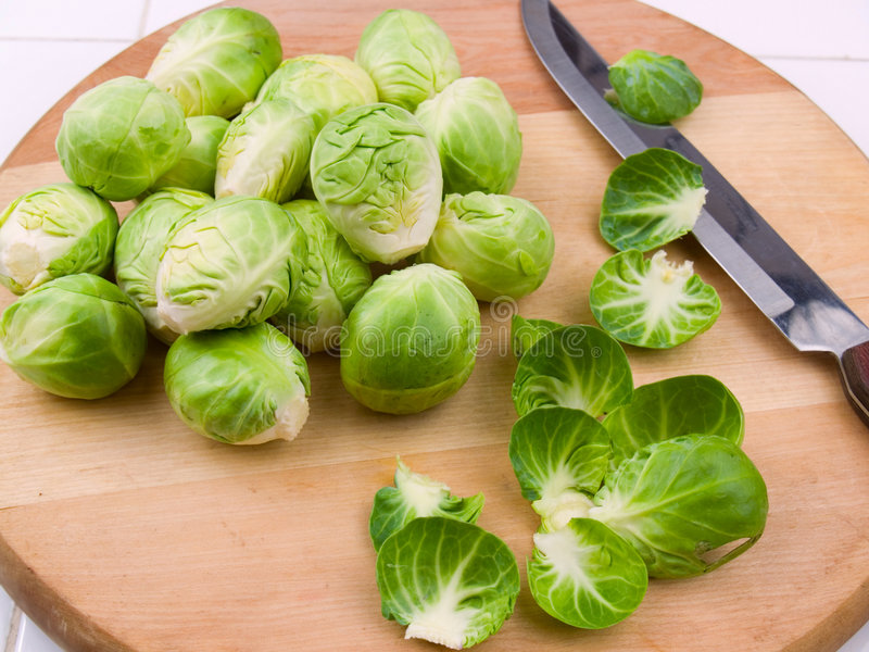 Fresh brussel sprouts. On a wooden cutting board royalty free stock image