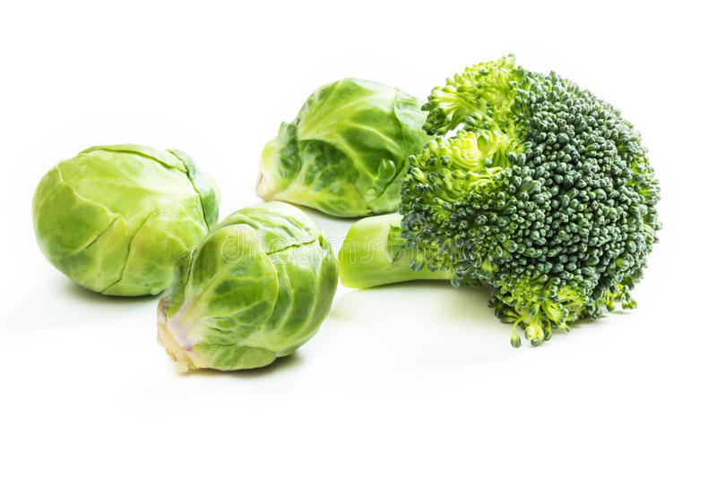 Fresh brussels sprouts and broccoli on white background. stock photography