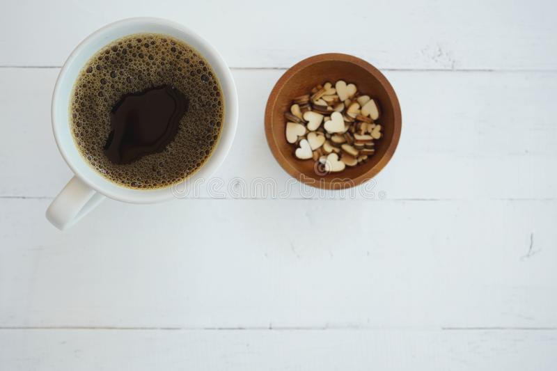 Fresh bubble hot black coffee in pure white ceramic cup on white wooden table, coffee love concept, copy space. Fresh bubble hot black coffee in pure white royalty free stock photography