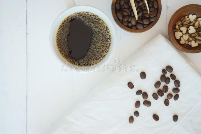 Fresh bubble hot black coffee in pure white ceramic cup on white wooden table, coffee love concept, copy space. Fresh bubble hot black coffee in pure white stock photography