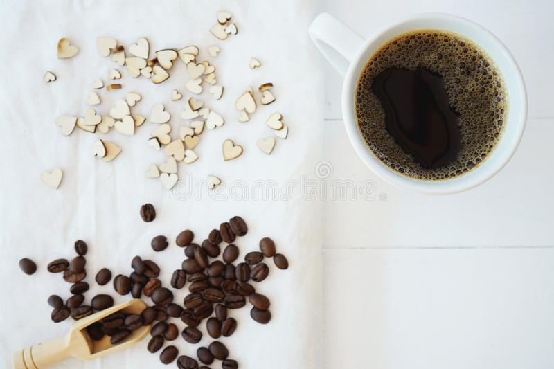 Fresh bubble hot black coffee in pure white ceramic cup on white wooden table, coffee love concept, copy space. Fresh bubble hot black coffee in pure white stock images