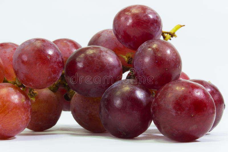 Fresh bunch of grapes isolated on white background with close up photo stock photos