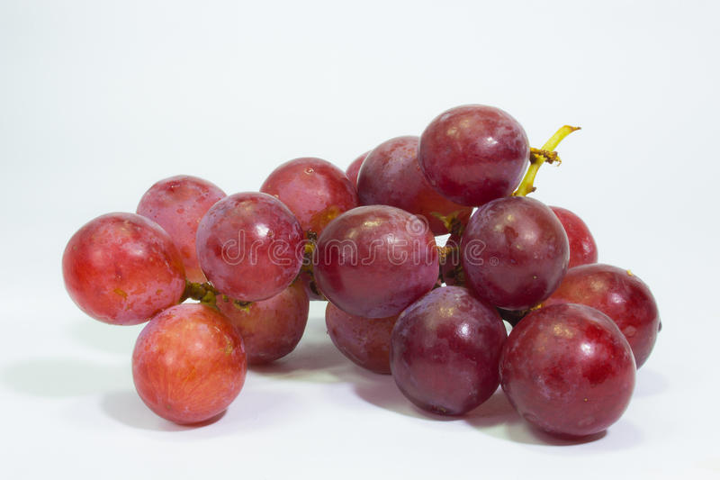 Fresh bunch of grapes isolated on white background royalty free stock photo