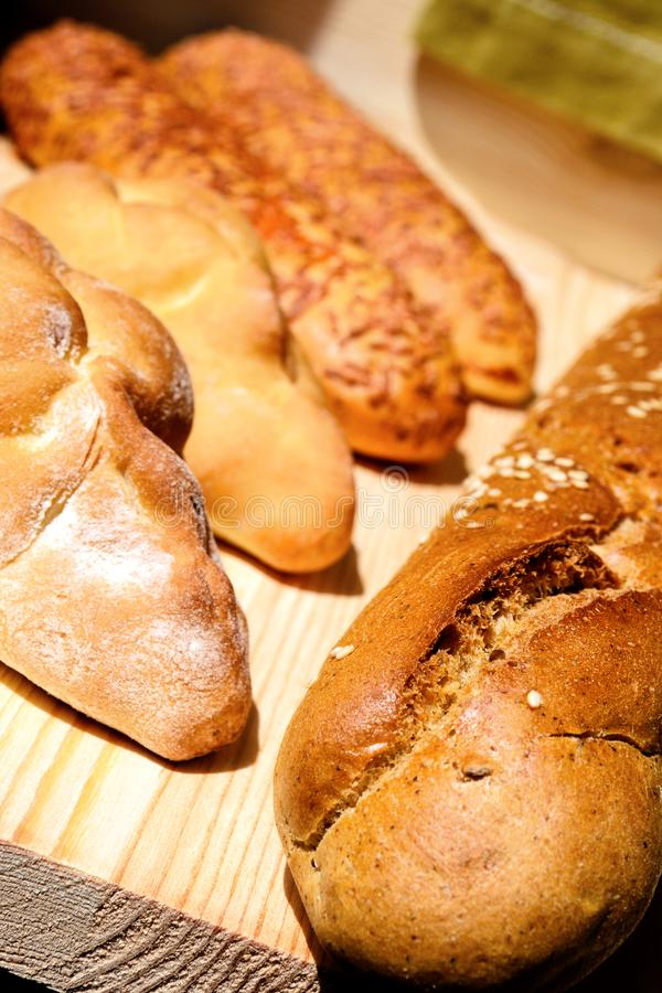 Fresh buns of different sizes royalty free stock photos