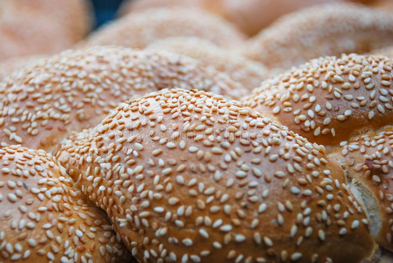 Fresh buns with sesame seeds royalty free stock image