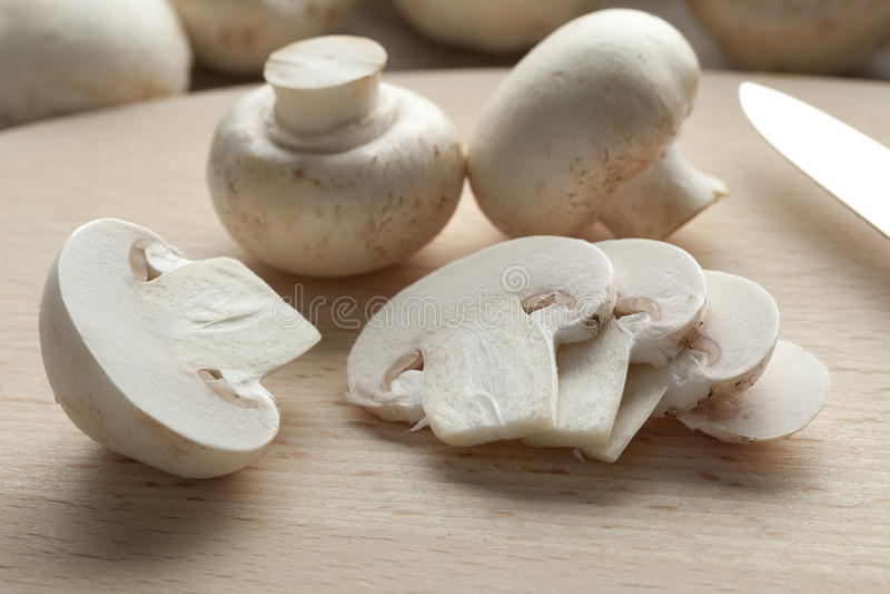 Fresh button mushrooms. Fresh chestnut mushrooms and slices royalty free stock photos