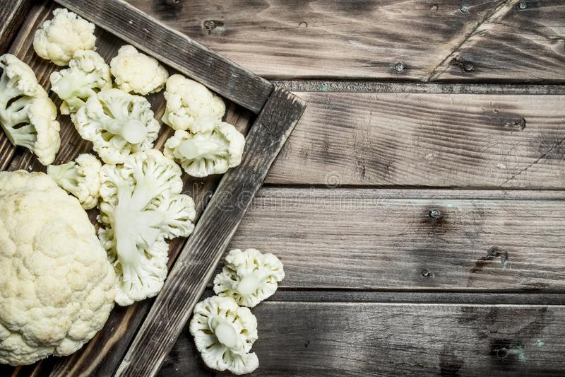 Fresh cabbage in a wooden tray. On a wooden background royalty free stock photography