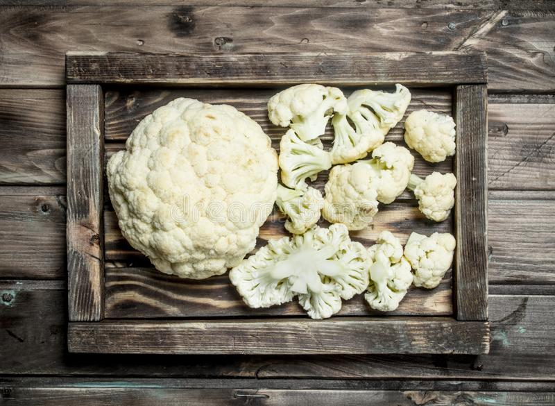 Fresh cabbage in a wooden tray. On a wooden background stock image
