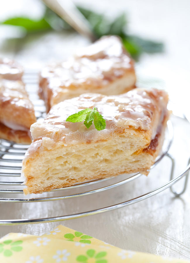 Fresh cake. Fresh piece of danish pastry cake with icing stock images
