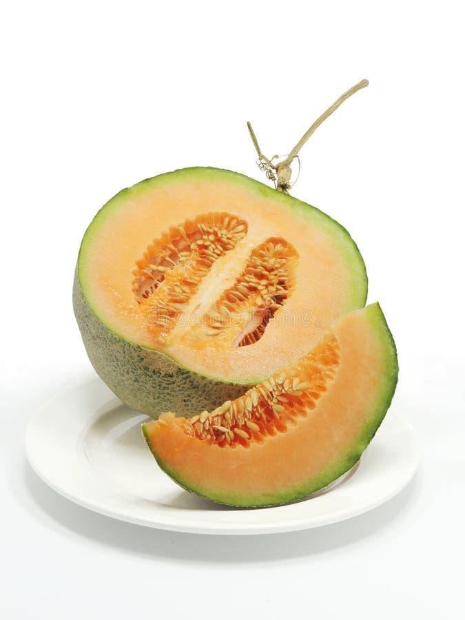 Fresh cantaloupe. On isolated background royalty free stock photo
