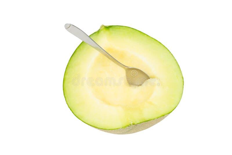 Fresh cantaloupe melon with Spoon isolated on white background stock image