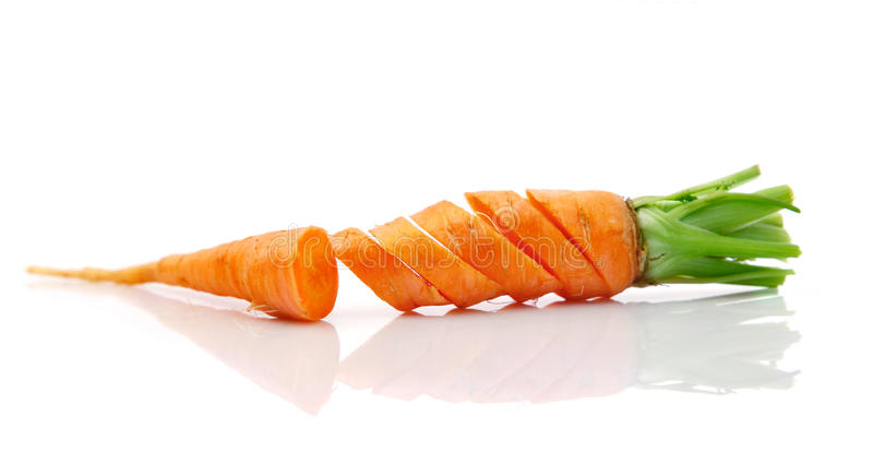 Fresh carrot fruits with cut royalty free stock photography
