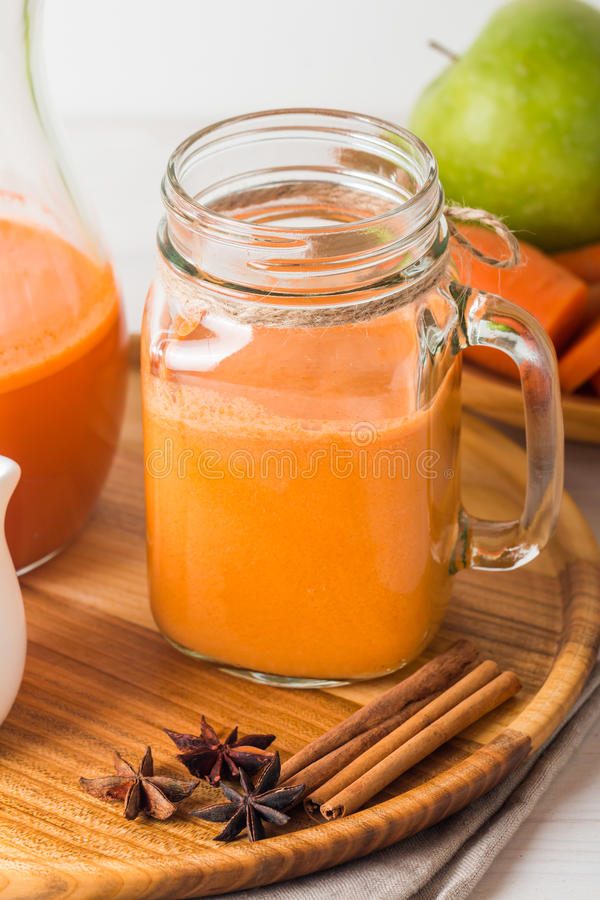 Fresh carrot juice in a glass royalty free stock photography