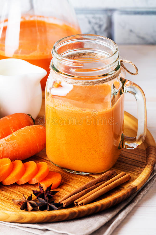 Fresh carrot juice in a glass stock image
