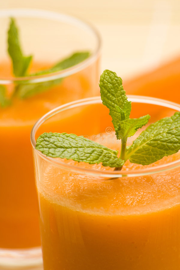 Fresh carrot juice and mint royalty free stock photography