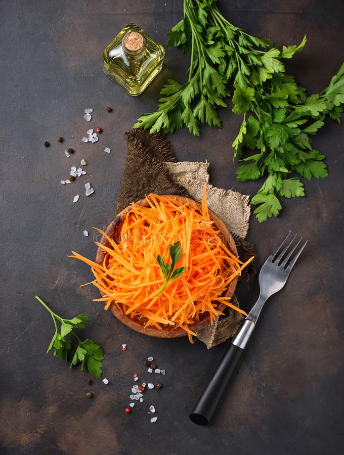 Fresh carrot salad on bowls. Selective focus stock image