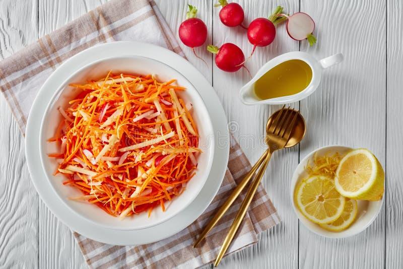 Fresh carrot salad in a white bowl stock photos