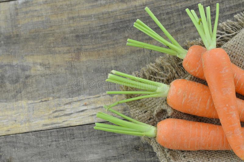 Fresh carrot on wooden background stock photography