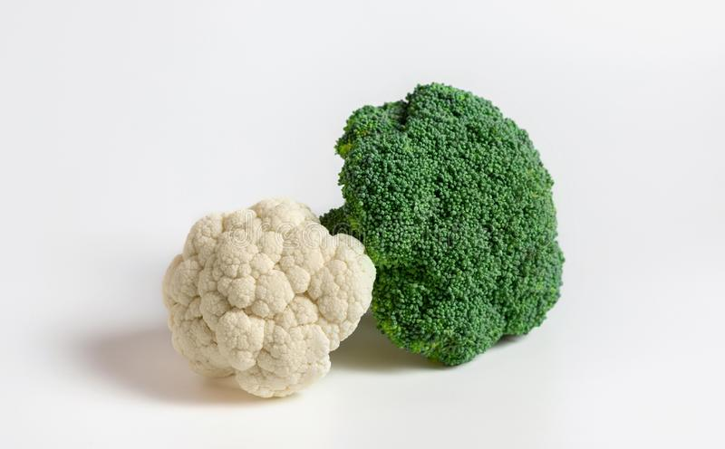 Fresh cauliflower and green broccoli on white background. Healthy natural organic food. Vegetables closeup royalty free stock photo