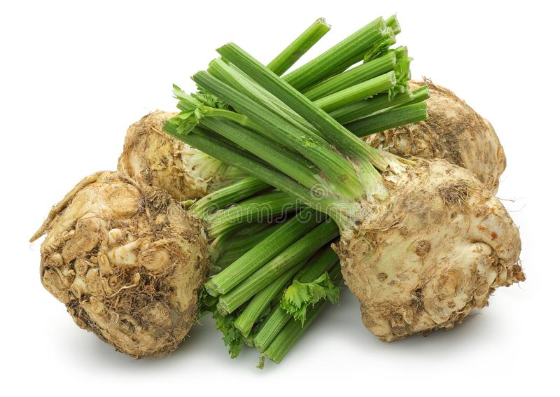 Fresh celeriac root with celery stalks isolated. Background stock image