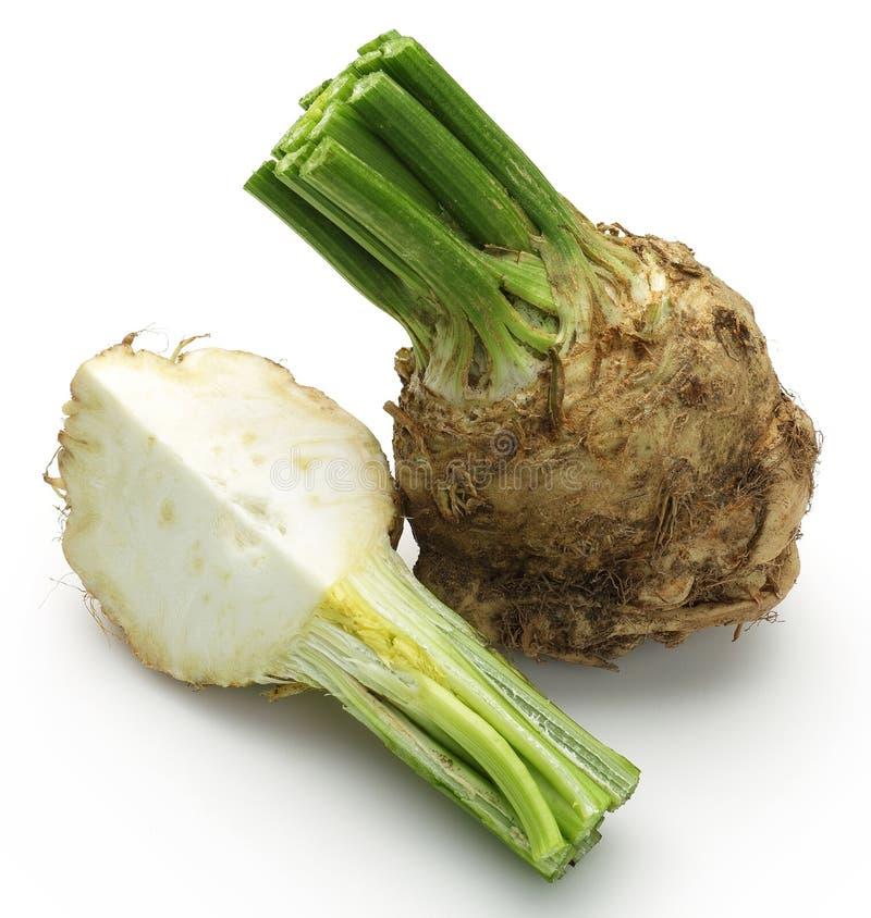 Fresh celeriac root with slice isolated. Background royalty free stock photo