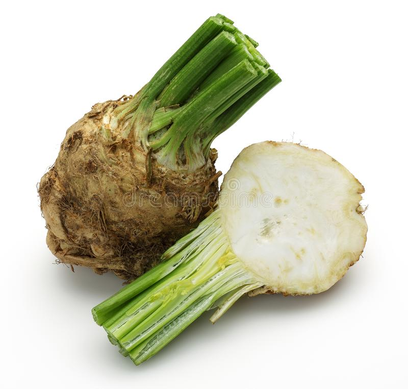 Fresh celeriac root with slice isolated. Background royalty free stock images
