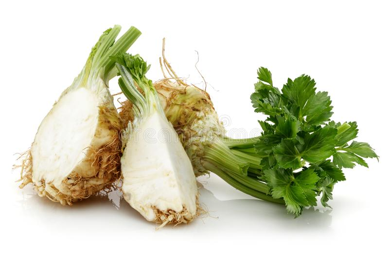 Fresh celeriac root with slice isolated. Background stock photography