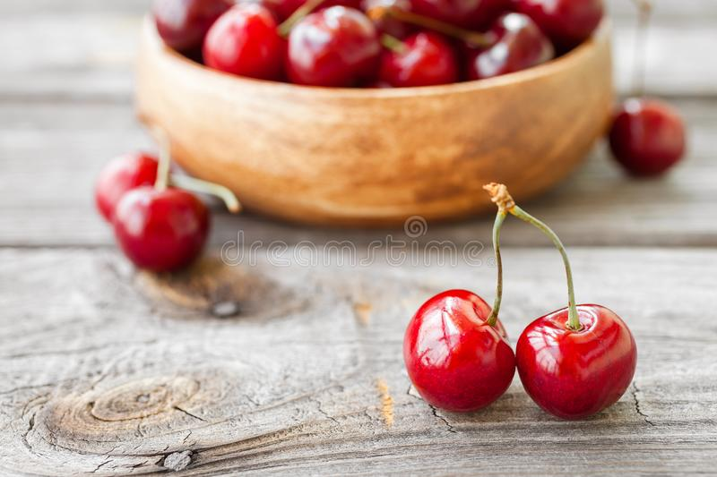 Fresh cherries on wooden background. Red ripe cherry stock image