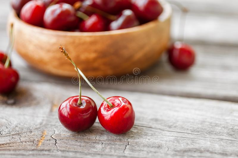 Fresh cherries on wooden background. Red ripe cherry stock photography