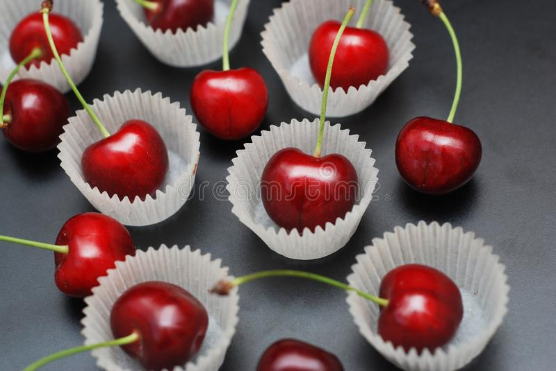 Fresh Cherry Fruit Health Vitamine in Cooking Bakery Cupcake Paper. Black Background Copy Space. stock photo