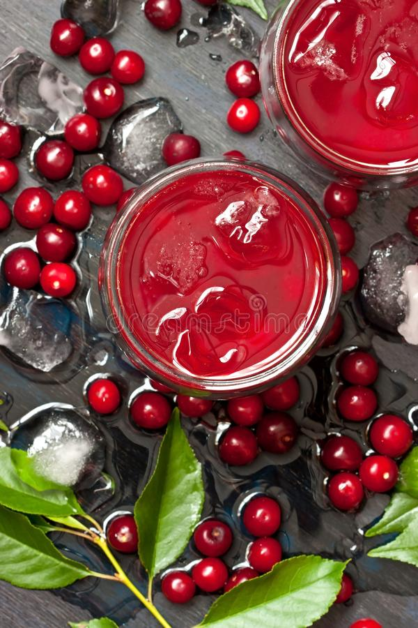 Cold drink with cherry in glasses stock photography