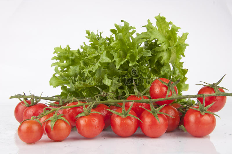 Fresh Cherry Tomatoes and Salad royalty free stock image