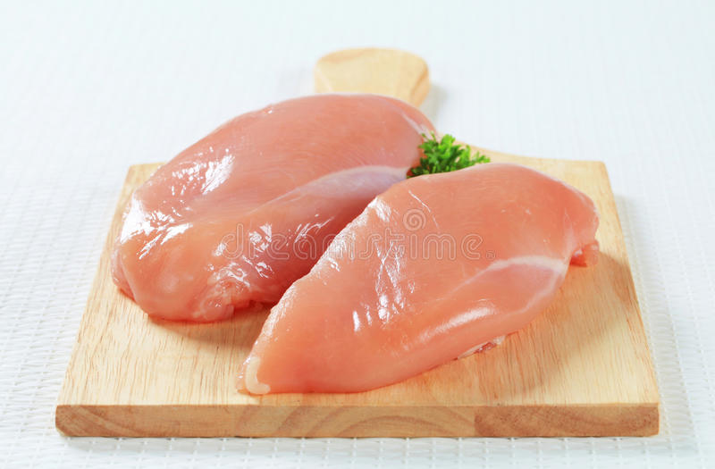 Fresh chicken breast fillets royalty free stock photos