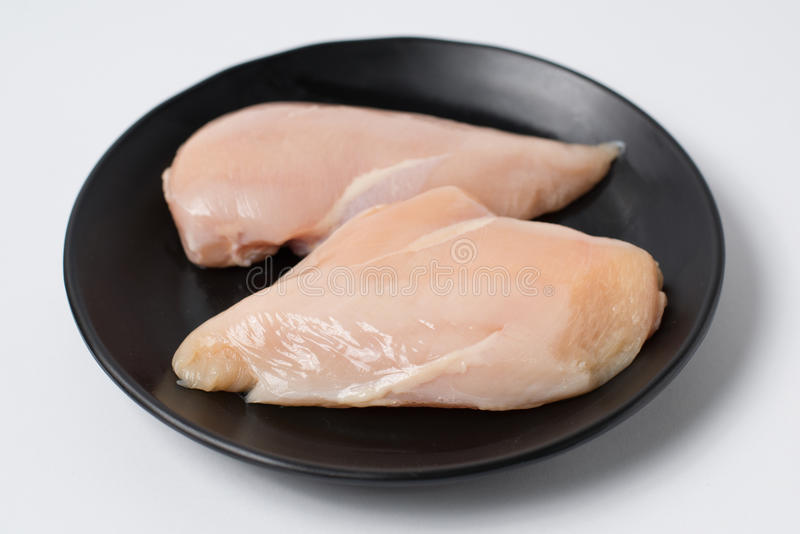 Fresh chicken breast fillets stock photography