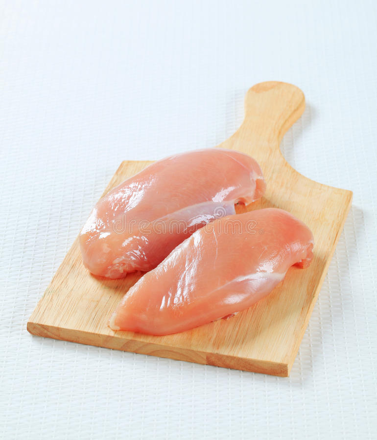 Fresh chicken breast fillets stock image