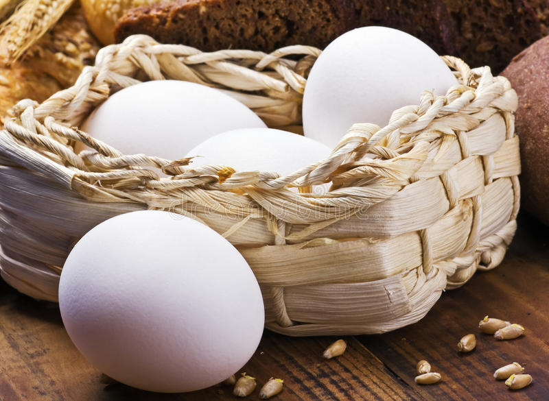 Fresh chicken eggs in a basket stock image