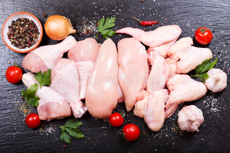 Fresh chicken meat. On dark board, top view royalty free stock photos