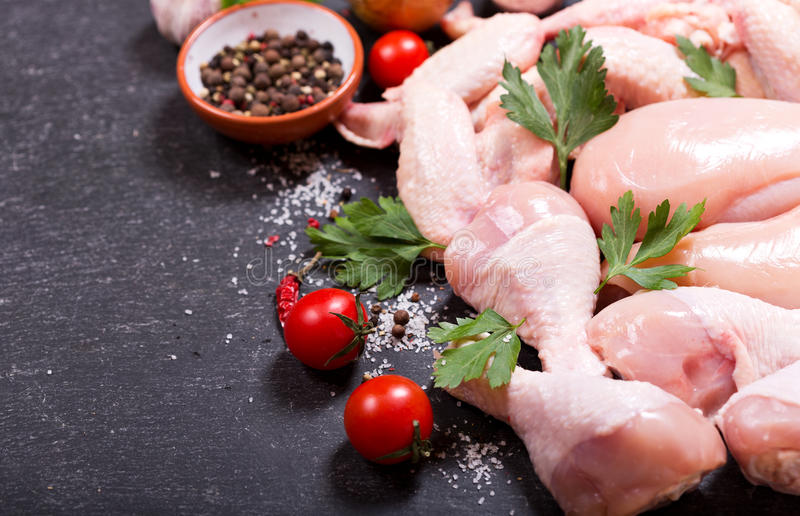 Fresh chicken meat. On dark board, top view with copy space royalty free stock photo