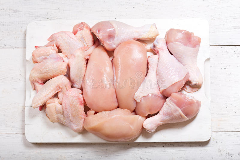 Fresh chicken meat. On wooden board, top view royalty free stock image