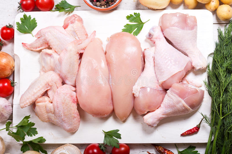 Fresh chicken meat. On wooden board, top view stock photos