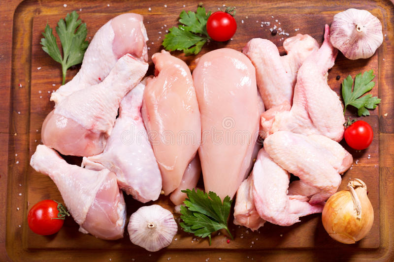 Fresh chicken meat. On wooden board, top view royalty free stock photography