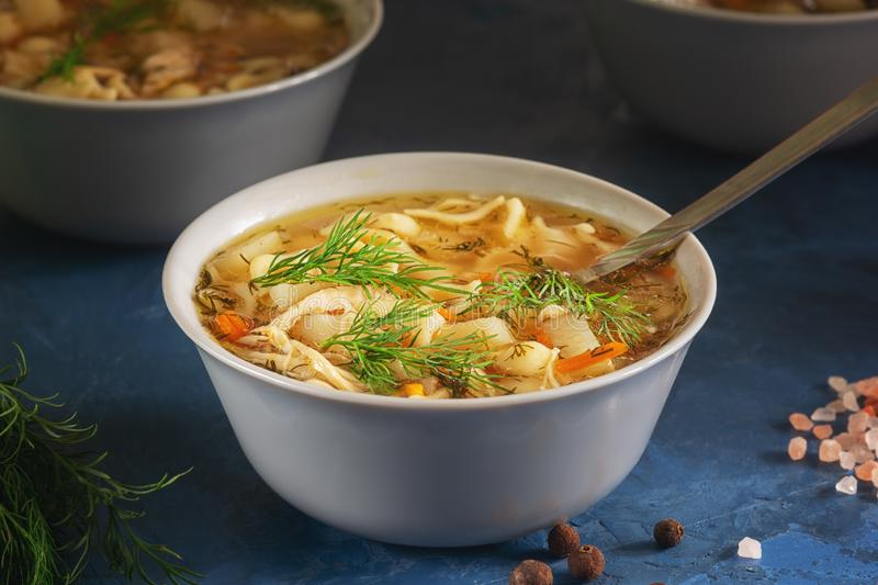 Fresh Chicken Noodle Soup Ceramic Bowl Closeup royalty free stock images