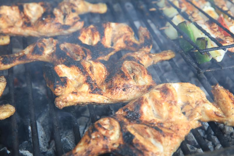 Fresh Chicken Wings on the charcoal Grill. Portugal royalty free stock image