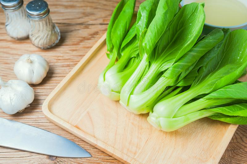 Fresh Chinese cabbage or Bok Choy vegetable. On wooden table background royalty free stock image