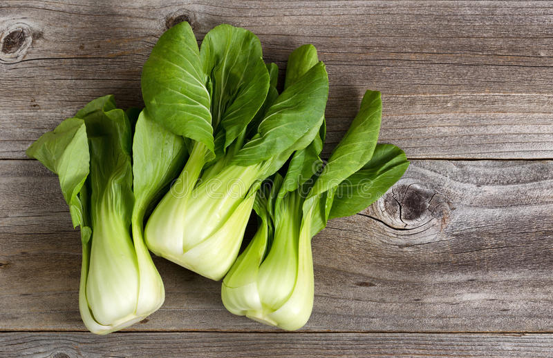 Fresh Chinese Cabbage on Rustic Wood royalty free stock photos