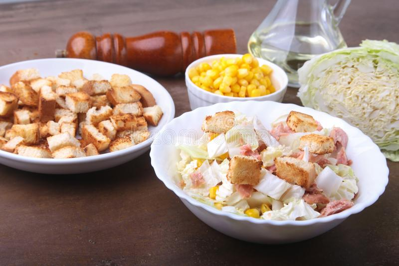 Fresh Chinese cabbage, Sweet canned corn, Delicious crispy croutons and canned tuna. Ingredients for dietary salad. stock photo